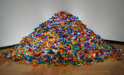 "I've seen this in person - the candy was actually quite tasty. cavetocanvas:  Untitled (Portrait of Ross in L.A.) - Felix Gonzalez-Torres, 1991 From the Art Institute of Chicago:  Felix Gonzalez-Torres produced work of uncompromising beauty and simplicity, transforming the everyday into profound meditations on love and loss. ""Untitled"" (Portrait of Ross in L.A.) is an allegorical representation of the artist's partner, Ross Laycock, who died of an AIDS-related illness in 1991. The installation is comprised of 175 pounds of candy, corresponding to Ross's ideal body weight. Viewers are encouraged to take a piece of candy, and the diminishing amount parallels Ross's weight loss and suffering prior to his death. Gonzalez-Torres stipulated that the pile should be continuously replenished, thus metaphorically granting perpetual life."