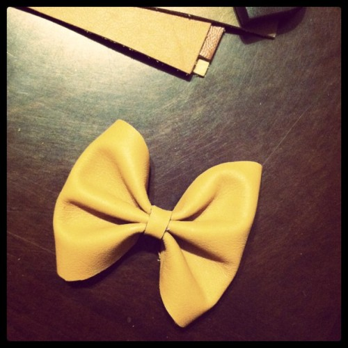 Making leather bows out of scraps of leather :)  (Taken with instagram)