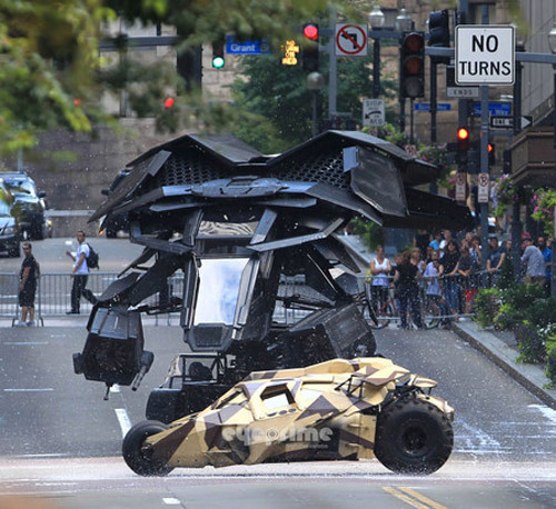 totalfilm:  The Dark Knight Rises: Batwing footage captured on set The elusive Batwing has been seen in action as it hovers back and forth underneath the 6th Street Bridge in downtown Los Angeles.  This video from YouTube was captured on a night shoot on 11 September 2011.  From this clip it looks as if the vehicle will use the same kind of thrust as a Harrier Jump Jet to power itself into the air and then speed away. Check out the sneaky clip here…