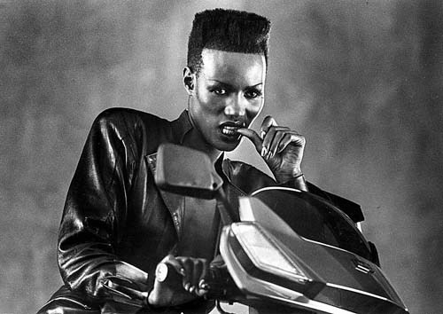 latimes:  May 19, 1985: Grace Jones poses for Los Angeles Times staff photographer Larry Davis during a break in the shooting of a Honda motor scooter commercial. Continue reading (and check out a couple more staff photos) at Framework.