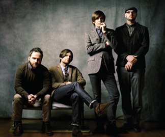 "Death Cab for Cutie's Ben Gibbard isn't shy. His wry, class-clown persona onstage is by no means a put-on. One on one, he still exudes that same charisma—except that he's also the boy next door who just happened to have his nose in a book and sky-high ambition. Even when approached with questions of faith—which Gibbard admits he doesn't have all the answers to—his confidence and charm remain unshaken. ""[Faith's] something I always find myself meditating on,"" he admits. ""I don't want to falsely believe in something solely so I can jump to the front of the line for whatever this awesome place is [where] we go after we die. I kind of feel like if there was a God, [He] would appreciate the fact that I just don't know. The vastness of that idea is so beyond my comprehension that I feel like if there was a God, then that God would accept me saying I'm not able to believe because it's so outside of my ability to understand it. I understand that's where faith comes into play."" (via RELEVANT Magazine - Death Cab for Cutie)"