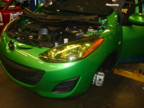 Yellow Lamin-X head light covers look good on the green paint