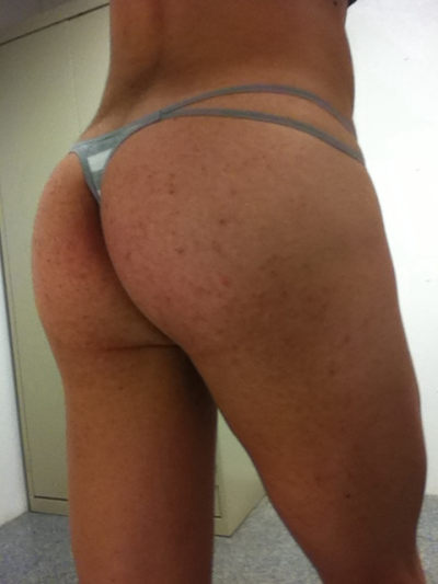 From behind. Nothing better than a skimpy thong under your work clothes.  I wonder if anyone knows that the guy they are talking to has vickies panties on…
