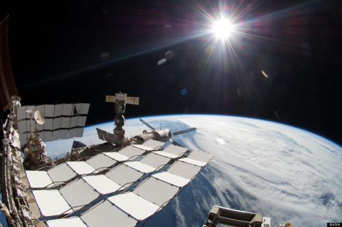 International Space Station Spacewalk Picture Shows Sun And Earth Together