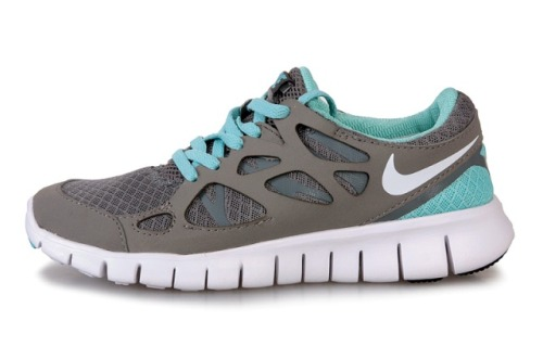 Nike Free Run +2 … Just ordered these to run in. So excited!! I've been wearing low-support shoes/going barefoot for over a year to work up to these guys. I just couldn't deal with the thought of wearing Vibram Five Fingers AND a fuel belt ;) I'll post a picture of THAT baby soon.