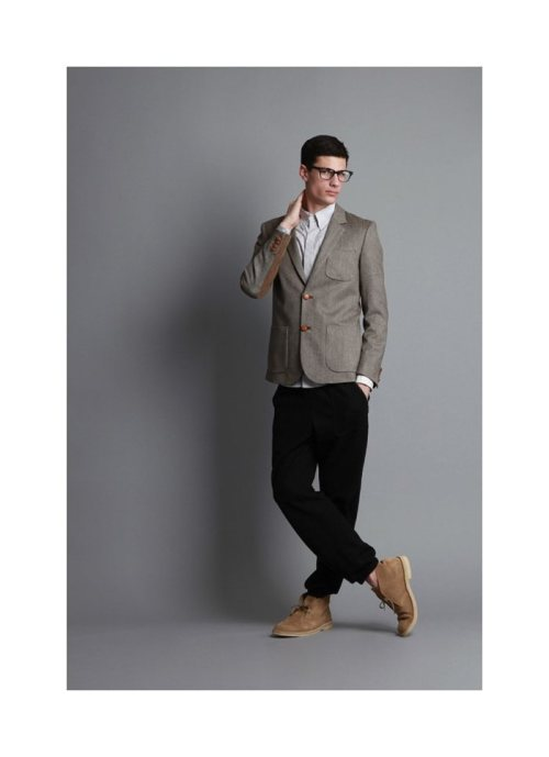 mensfashionworld:  AR by Aloha Rag Fall 2011   A blazer this short should be as appalling to you as ass-sagging pants.  I mean, it barely passes his belt-line and reveals his (improper) untucked shirttails.  Sure, you're wearing a blazer, but you still give off a sloven look.  Whoever styled this ass-clown should blacklisted from the industry forever.