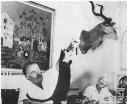Ernest Hemingway with kitty (you can tell he liked kitties better than other animals).