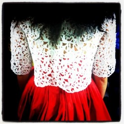 teenvogue:  Lace top and luminous skirt backstage at Oscar de la Renta. Photographed by Eva Chen.