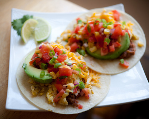 healthyalternative:  Breakfast Tacos! Corn tortillas, refried beans, scrambled eggs with adobo and spices, avocado, cheese, scallions and a fresh homemade salsa consisting of tomato, corn, red onion, garlic, cilantro, lime, red wine vinegar, salt and pepper. 390 Cal