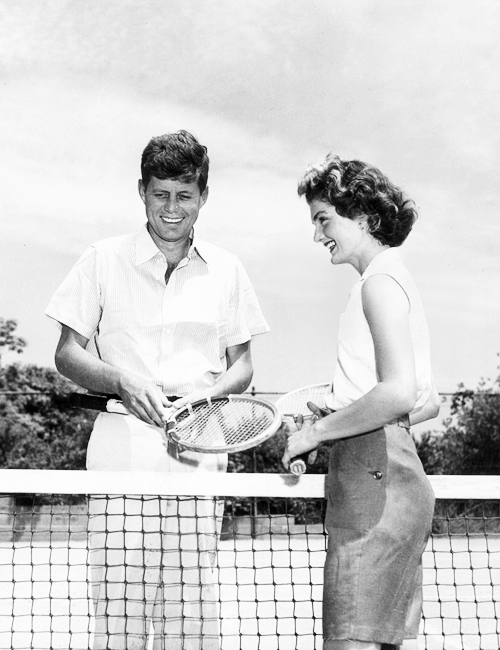 missavagardner:  Senator John F Kennedy and his wife, Jacqueline, stand on either side of a tennis net, holding tennis racquets, Hyannis Port, Massachusetts.