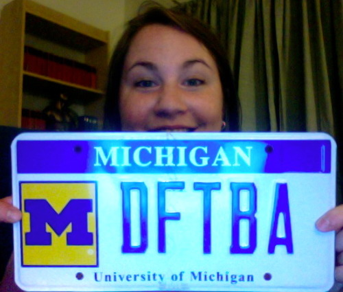 effyeahnerdfighters:  I just moved to Michigan for graduate school and decided to splurge on a specialized license plate.  It got here today and I had to upload a picture to effyeahnerdfighters immediately—can you tell that I'm a bit excited?  It is definitely worth every penny! [Submitted by Jennifer]  When we moved to Indiana, I tried to get a DFTBA license plate, but it was already taken.