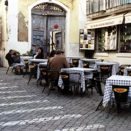 Sidewalk cafe in downtown Lisbon  |  by Peter Gutierrez