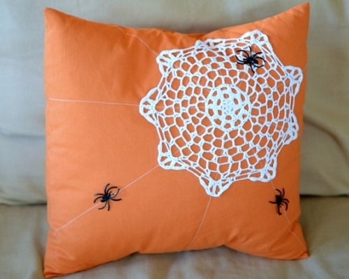 Spider Web Doily Pillow. From Crap I've Made here. That's why I love Tumblr. I can go from an exquisite felt creature to a Halloween pillow! Doily found at Dollar Store.