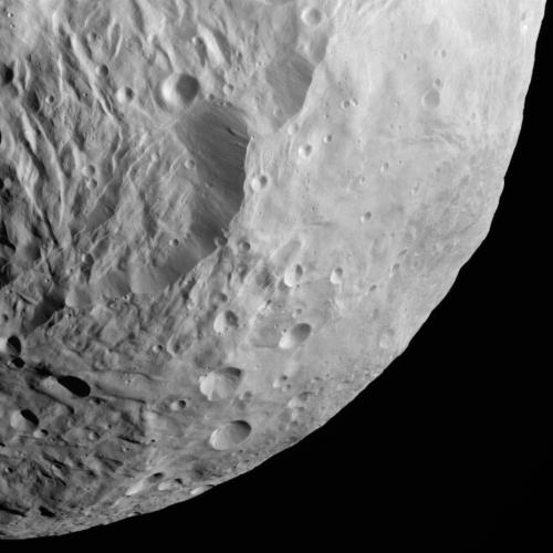 unknownskywalker:  Steep Slope on Vesta NASA's Dawn spacecraft obtained this image with its framing camera on Aug. 26, 2011. This image was taken through the camera's clear filter. The image has a resolution of about 260 meters per pixel.