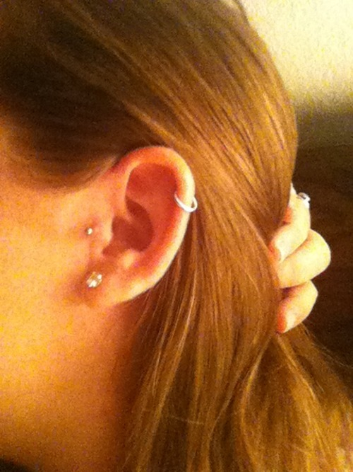 My ear looks amazing :)  got a smaller hoop for my cartilage and hopefully changing my plain tragus labret to one that has a diamond on it soon (once this second round of hypertrophic scar tissue goes away, ughh)
