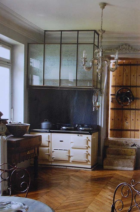 tamsinjohnson:  Aga and glass range hood  An Aga furnishes a room.