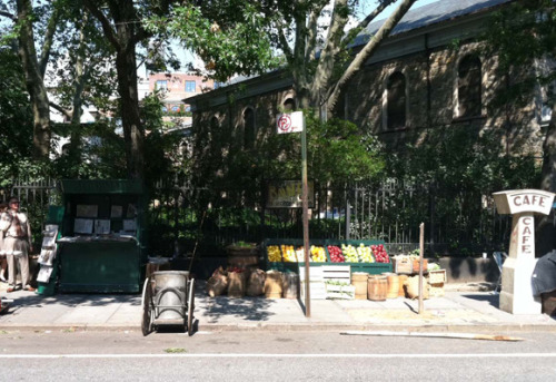 the fence outside St. Mark's Church became an old-time fruit stand stuyvesant square transformed into a rainy day in paris in the 1920's (gvshp) not really related: six ways to feel French in New York City
