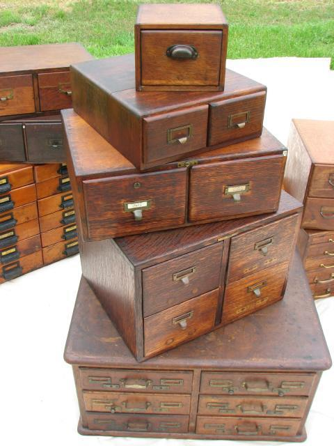 I find myself very attracted to filing cabinets and card catalogs and chests of drawers in general, mainly because I'm an incredibly disorganized person who believes that if she could find *just* the right system, she could get organized: 51 drawers in 10 cabinets, ca 1900-1930