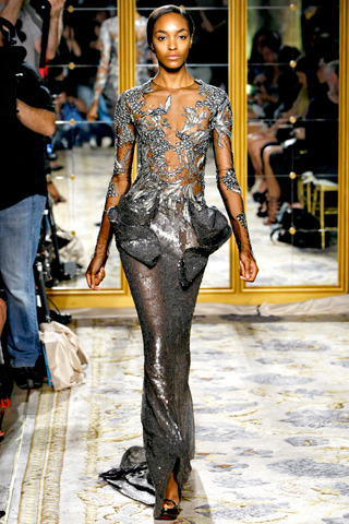 Marchesa Spring RTW 2012 NYC Fashion Week Photo via Style.com  An edgy, sexy brocade gown by Marchesa. Some of their collection has a 1920's flapper feel.