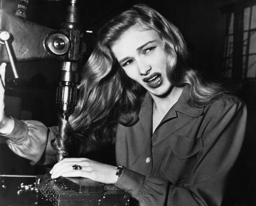 November 9, 1943 American film actress Veronica Lake, illustrates what can happen to women war workers who wear their hair long while working at their benches, in a factory somewhere in America. (via The Atlantic)