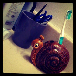 This snail toothbrush holder is my favorite vintage bathroom decor!