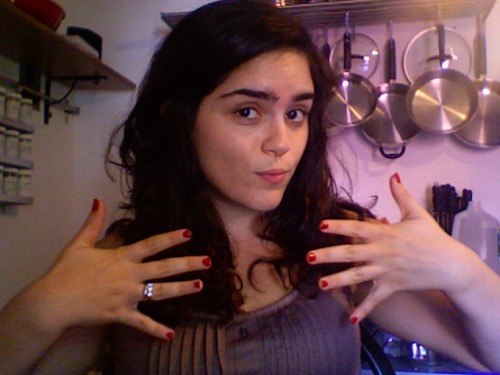 Showing off two things here: my new hair (yay!) and my nails which I did all by my lonesome. The color is Forever Yummy by my fave, Essie. (Just bought Turquoise and Caicos and In A Stitch today, too…)