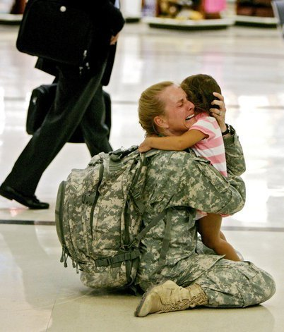 [ Image: A soldier returning from deployment greets her child. ] ruckawriter:  Welcome home, soldier.