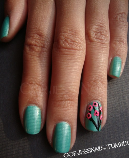 Sinful Colors- Mint Apple with cherry blossom accent nail.