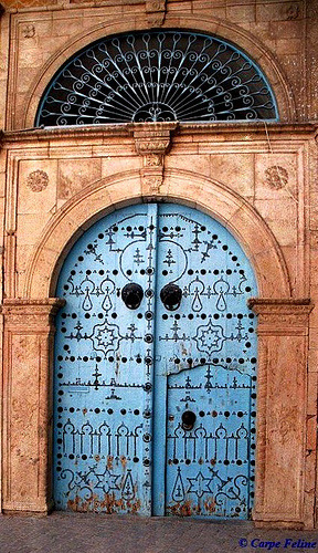 souls-of-my-shoes:  Tunisian doors.. always bright and decorated and wonderful!