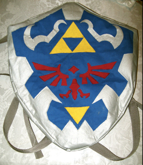 spookyhouse:   Hylian Shield backpack  oh man i want this  NEED LIKE BURNING