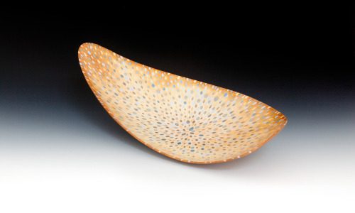 "Mark Goudy: Surface (p47) - 17.5""w x 4""h; handbuilt burnished earthenware, soluble metal salts, fired to cone 04"