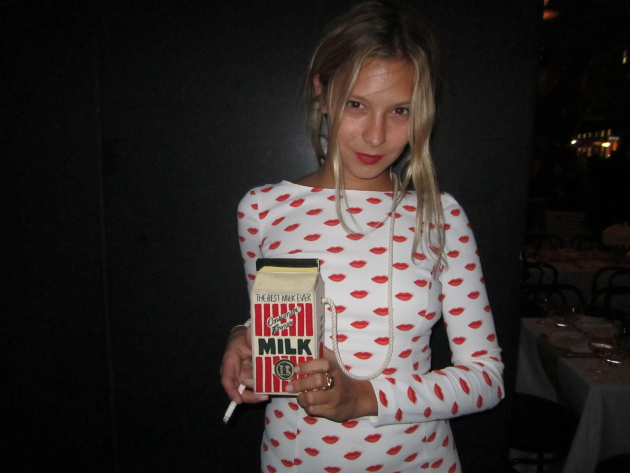 Annabelle Dexter-Jones wearing a Prada dress and a Milk Box bag by Olympia Le-Tan at the Standard Grill for André's L'Officel Hommes dinner in New York.