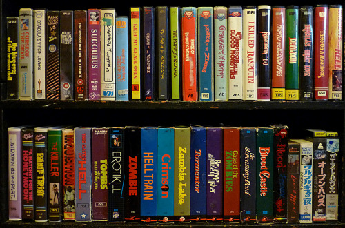 About 1/4 of my Horror VHS Collection.  Wish I had room to put the rest out.