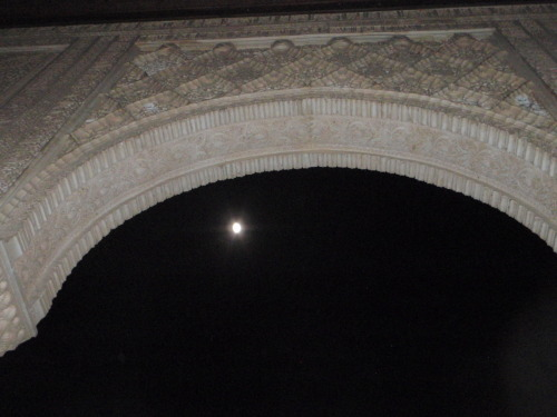 Arabesque and moon. The Alhambra in Granada, Spain.