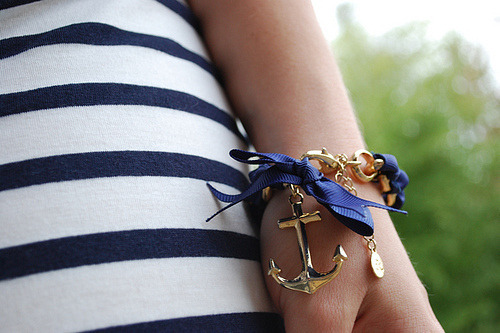 Nautical anchor bracelet with navy stripes.