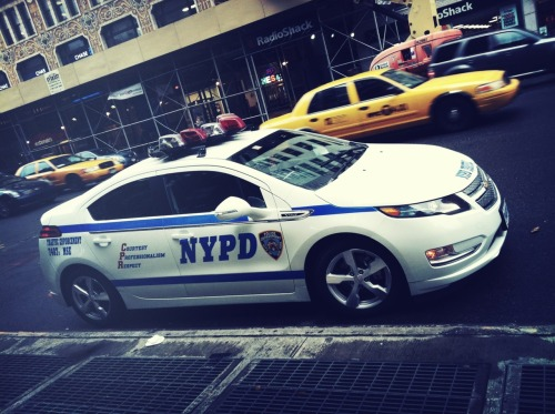 "NYPD gets Chevy Volts: This is very cool. With most police depts nationwide going to the ""paddy wagon"" style of transferring arrested suspects to holding facilities, there is no longer a need for police officers to drive bulky, gas guzzling Crown Victorias or even the mid-size Impalas. Before you cite the need for speed, take into account most cities have put a 100 MPH limit on police chases in the wake of numerous civilian vs. municipal lawsuits, thereby eliminating the need for a police vehicle to be in excess of 100 mph. This makes great ecological and economical sense. —John Cannonwww.mycardoc.com theautoinsider:  NYC Street Spot The second of the NYPD's fleet of Chevrolet Volts I've seen, but first I've been able to capture on ""film."" Spotted at W. 14th and 7th Ave on my way back from getting my hairs did at Freemans."