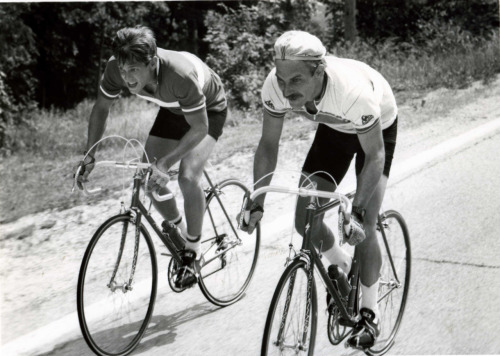 David Marshall Grant and Kevin Costner ride bikes.