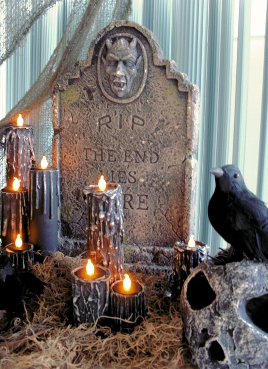 truebluemeandyou:  DIY Black Drippy Creepy Halloween Candles. Tutorial from The House of Dewberry here. Photo doesn't do these candles justice. Posting because you use paper and toilette paper rolls, plastic tea lights, glue gun and paint. Great tutorial.