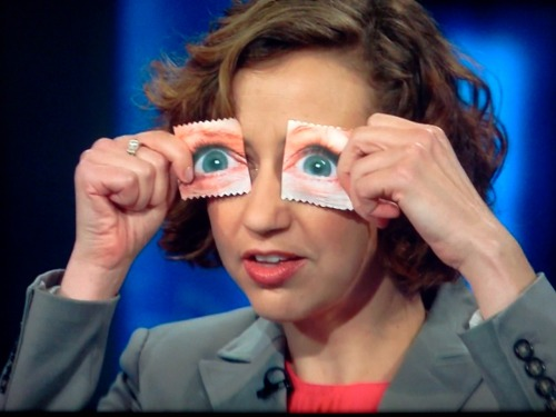 ratsoff:   Kristen Schaal shows off Michele Bachmann's 'I've Got My Eye On Your Vagina' brand condoms on The Daily Show.  (via inothernews.)