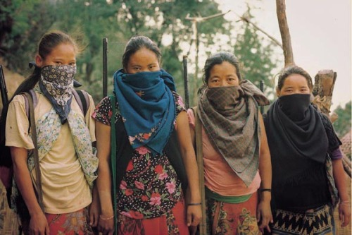 punkysdilemma:  Nepalese Maoist guerrillas looking mad awesome in textile pattern clashes (apparently 40% of the guerrilla movement is made up of women, carving a new role for themselves in a fiercely patriarchal society)