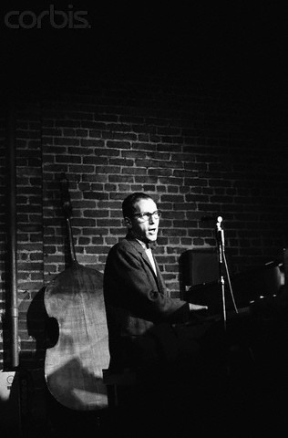 Tom Lehrer sings and plays piano at the Hungry I Nightclub in San Francisco, June 1, 1965 photographed by Ted Streshinsky.