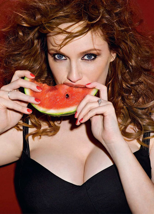totalfilm:  30 Sexiest Christina Hendricks Moments 12. Mouth WateringThe Sexy Moment: We've had Angelina Jolie sucking on strawberries, but Christina Hendricks blows the fruit-eating competition out of the water with, fittingly, this watermelon. We've never wanted to be a piece of fruit so much before.If It Was Frumpy: There'd be an 'after' photo in which a grinning Hendricks is blissfully unaware that her teeth are full of pips.[FOR 29 MORE SEXY CHRISTINA HENDRICKS MOMENTS, CLICK THE IMAGE ABOVE OR FOLLOW THIS LINK]  Yummy red heads, iunno if she's the SEXIEST woman alive. I wouldn't throw her out of bed if you know what I mean though.