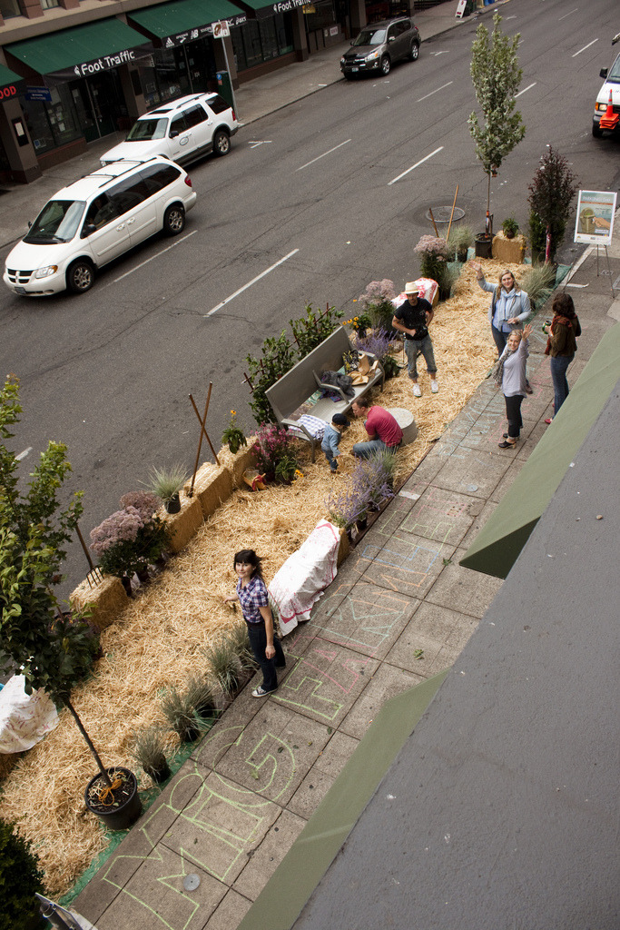 Via steveleathers:  For PARK(ing) Day, my company created an Urban Farmlet on SW 2nd Street in Portland (between Taylor and Yamhill).   It's only two parking spots, but it feels like a lot more. If you're in the area, come by and check it out. Have some lemonade. Enjoy some space that you normally wouldn't have the chance to.   Happy 2011 PARK(ing) Day, y'all.   PARK(ing) Day is an annual, worldwide event that invites citizens everywhere to transform metered parking spots into temporary parks for the public good.  Click here to view a map of cities where residents have set up pop-up parks.  See also: Earlier Gardens in Unexpected Places post here.