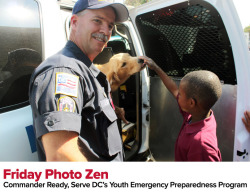 Commander Ready participant meets police dog  Since it's National Preparedness Month, I thought this adorable shot from Serve DC's 2011 Commander Ready Kickoff was just too presh to resist. Commander Ready is an program designed to introduce elementary-school age kids to emergency preparedness in a fun, safe way.