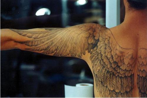 thelittlekneesofbees:  toburnbright:  Oh, wow. The usual version of wing tattoos where they're folded up against the shoulder blades doesn't appeal to me but these… oh yes.  Reminds me of of the fic Pilot Light, by L.Greene.