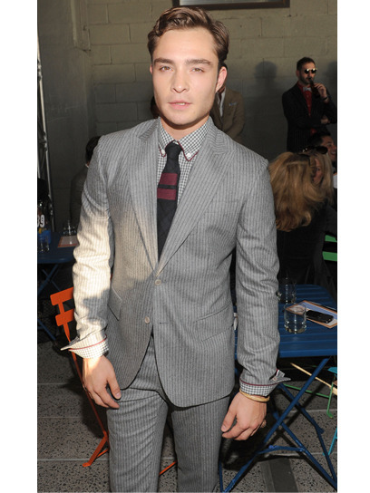 Ed Westwick looked dapper sitting front row at Tommy Hilfiger in a pinstriped light grey suit. Check out more stars, artists and bloggers who had the hot seats at NYFW »