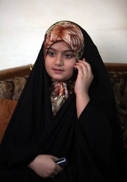 #Iraq Tabarak Thaer (10 years) She is a survivor of a hijacking left 22 Shiite pilgrims dead on Monday Sept. 12, 2011 in Iraq's Sunni-dominated western Anbar province . The passengers were from Karbala and were headed to the Sayyida Zainab shrine in Damascus, Syria. (AP Photo/Ahmed al-Husseini). تبارك ثائر، ١٠ سنوات، احدى الناجيات من مذبحة الانبار ١٢ آيلول، حيث قتل ٢٢ من الشيعة كانوا في طريقهم من كربلاء الى سوريا لزيارة مرقد/ ضريح السيدة زينب هناك.