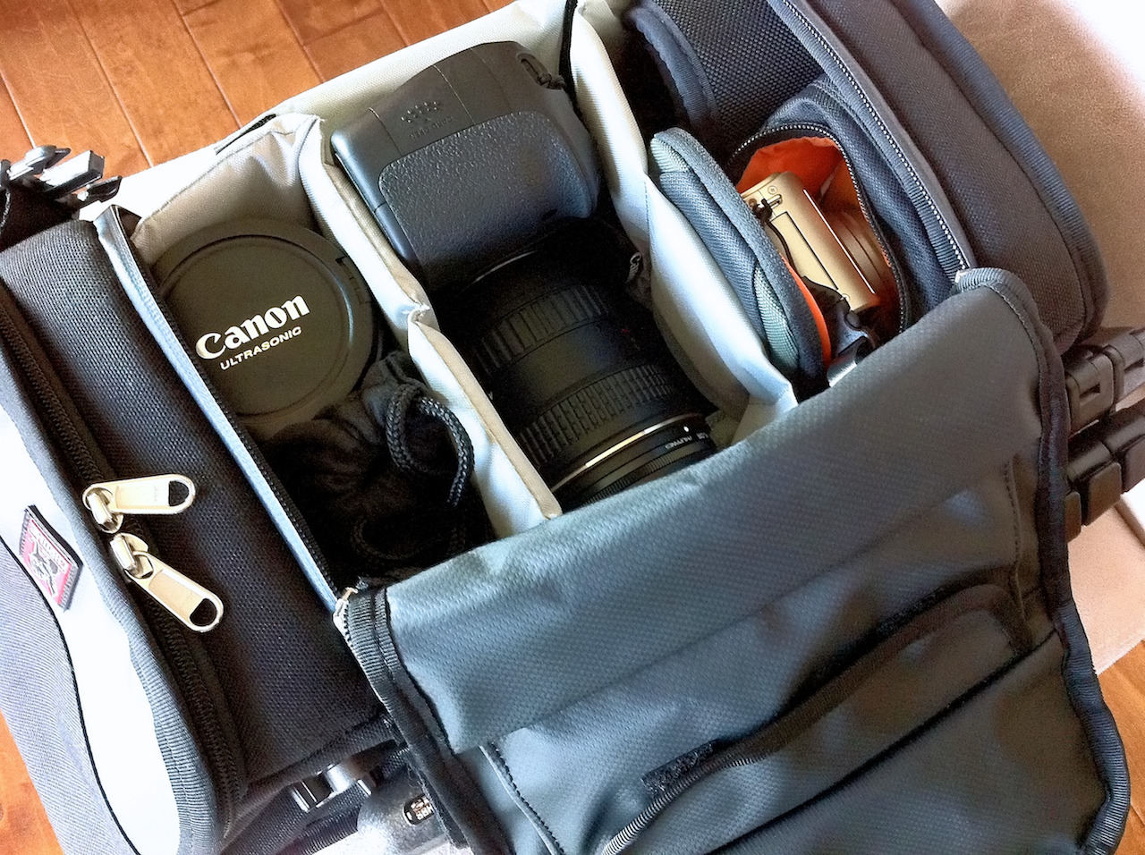 Lovin' my new camera bag!  My old camera bag still had storage areas for film, so I thought it was time for an update before I head to Ireland soon.   Not only is the Chrome Niko camera bag stylish, it's also very functional.   Its sling-style strap is great, and the bag perfectly fits all of the gear that I'm taking on the trip:  Canon 60D Canon 24-105mm f/4 Tokina 12-24mm f/4 Canon 50mm f/1.8 Lumix LX5 (inside of a Lowepro Apex 60 AW bag) Black Rapid RS-7 strap A couple of Hoya Filters in the main flap Chargers, Canon Remote, extra SD CARDS, Monster Outlet, power plug adapter, and OP/TECH rain sleves in the top Slik Sprint Mini II Tripod attached to the side [click on any item above for more info]