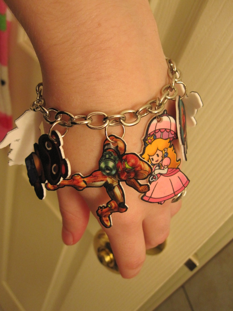 pale-little-thing:  Cute little Nintendo charm bracelet I made. (My Etsy)