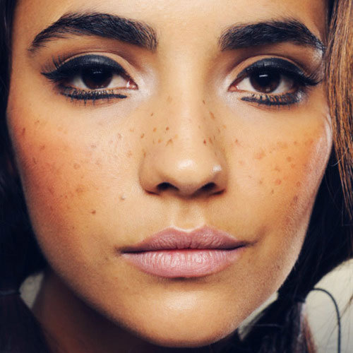 Fake freckles! How cute! Read more about the backstage beauty seen at the Jeremy Scott Spring 2012 show!